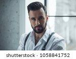 portrait of handsome confident... | Shutterstock . vector #1058841752