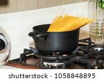 pot with pasta on the stove | Shutterstock . vector #1058848895