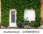 green plant wall building... | Shutterstock . vector #1058848922
