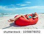 girl relaxing on lamzac and... | Shutterstock . vector #1058878052