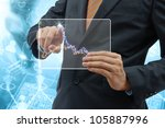 Business people drawing a graph by finger on glass tablet touch screen. - stock photo