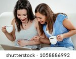 young women drinking coffee and ... | Shutterstock . vector #1058886992