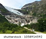 briksdalsbreen is a glacier arm ... | Shutterstock . vector #1058914592
