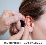 doctor putting acupuncture...   Shutterstock . vector #1058918222