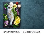 fresh fish dorado. raw dorado... | Shutterstock . vector #1058939135