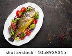 baked fish dorado. dorado fish... | Shutterstock . vector #1058939315