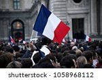 Small photo of Supporters of French presidential election candidate Emmanuel Macron wave French national flags as they celebrate in front of the Pyramid at the Louvre Museum in Paris on May 7, 2017.
