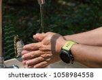 people wear a waterproof watch... | Shutterstock . vector #1058984558