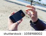 woman using mobile phone.... | Shutterstock . vector #1058988002