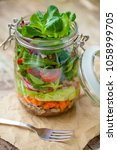 portable layered salad in glass ... | Shutterstock . vector #1058999705