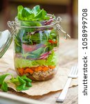 portable layered salad in glass ... | Shutterstock . vector #1058999708
