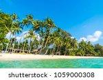 beautiful tropical beach and... | Shutterstock . vector #1059000308