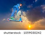 boy with push scooter jumps... | Shutterstock . vector #1059030242