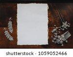bride's jewelry lie on a wooden ... | Shutterstock . vector #1059052466