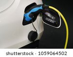 car electric charger were being ... | Shutterstock . vector #1059064502