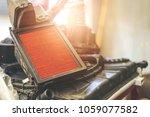 closeup old air filter for car... | Shutterstock . vector #1059077582