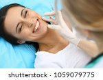 young female patient visiting... | Shutterstock . vector #1059079775