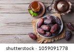 fresh medjool dates in a bowl... | Shutterstock . vector #1059091778