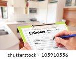 hand writing an estimate on a... | Shutterstock . vector #105910556