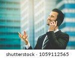 happy businessman in suit and... | Shutterstock . vector #1059112565
