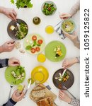 people at dinner table | Shutterstock . vector #1059125822