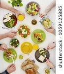 friends having dinner | Shutterstock . vector #1059125885