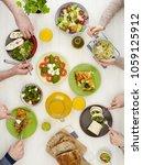 family dinner from above | Shutterstock . vector #1059125912