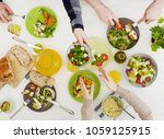 people at dinner table | Shutterstock . vector #1059125915