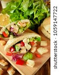 caesar salad in pita bread on a ... | Shutterstock . vector #1059147722