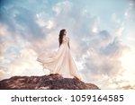 beautiful girl in a light...   Shutterstock . vector #1059164585