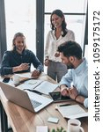 discussing business details.... | Shutterstock . vector #1059175172