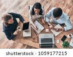 talking about business details. ... | Shutterstock . vector #1059177215