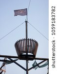 Small photo of The mast of a pirate ship, a ship, wooden ceilings on a ship, a pirate flag, a blue underdog, a black flag against the sky, a blank for the designer