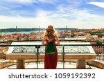 woman wearing portuguese flag... | Shutterstock . vector #1059192392