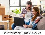 young couple moving in new home.... | Shutterstock . vector #1059202295