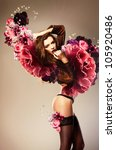 beautiful erotic woman with flower wings - stock photo