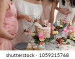group of women at a baby shower ... | Shutterstock . vector #1059215768