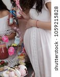 group of women at a baby shower ... | Shutterstock . vector #1059215828