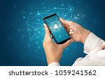 female hand using smartphone to ... | Shutterstock . vector #1059241562