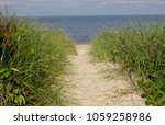 sandy beach pathway through...   Shutterstock . vector #1059258986