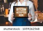 close up woman barista holding... | Shutterstock . vector #1059262568