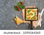 omelette with asparagus  cherry ... | Shutterstock . vector #1059264365