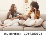 two women talking about... | Shutterstock . vector #1059280925