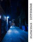 dark and eerie urban city alley ... | Shutterstock . vector #1059306068