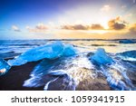 ice rock with black sand beach... | Shutterstock . vector #1059341915