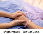 the hand of the woman is... | Shutterstock . vector #1059352856