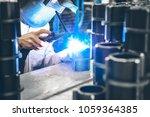 industrial worker in... | Shutterstock . vector #1059364385