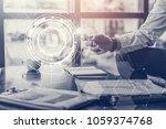 hologram of technology icons on ... | Shutterstock . vector #1059374768