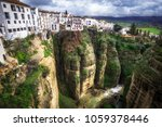 ronda is a mountaintop city in... | Shutterstock . vector #1059378446