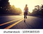 fitness sportswoman running on... | Shutterstock . vector #1059385535